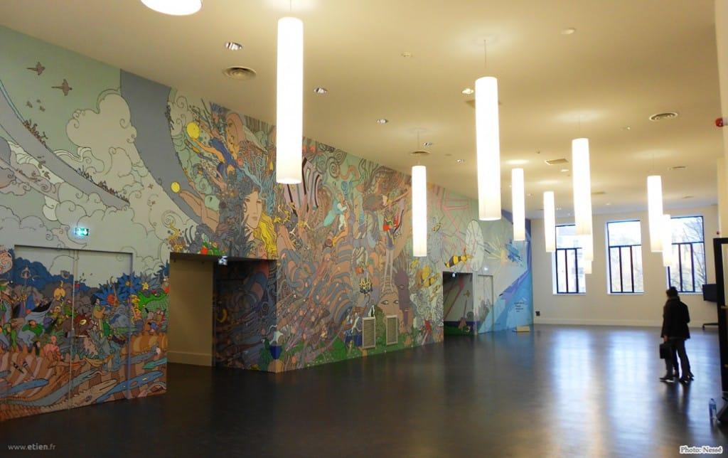 """Participation à la peinture d'une fresque créée par Moebius - <em>Réalisé par 7ème Sens</em><br/> Acrylique sur bâche toilée - 150m2 env.<br/> Montrouge (92) - 2012 - <em><a href=""""http://etien.fr/moebius"""" target=""""_blank"""">voir + de photos</a></em>"""